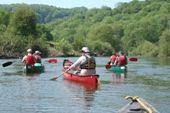 Wye Canoes guide with a group near Yat Rock