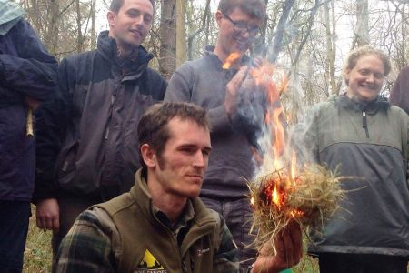 A Wye Adventures instructor demonstrating fire by friction.