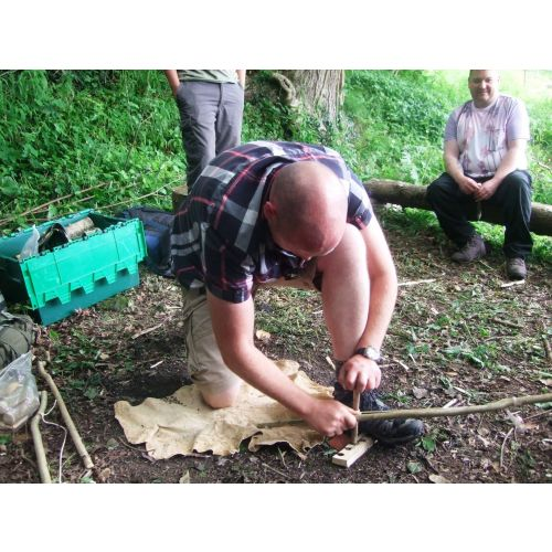 Learning how to use bow drill in a bushcraft session.