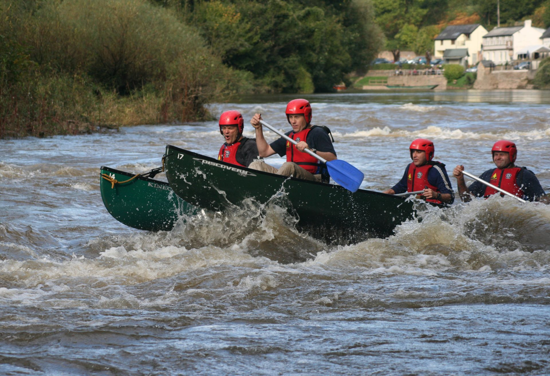 Rafted canoe having fun in the rapids at Symonds Yat